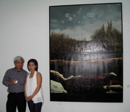 "Geraldine Javier and Ateneo's Leo Garcia with her piece, ""Bubbles In His Head"""