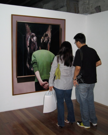 "Mona and Soler Santos viewing Annie Cabigting's ""Viewing Bacon"""