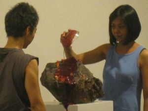 "Sandra Palomar and Ringo Bunoan executing Paul-Armand Gette's ""The Goddess Menstruating"""